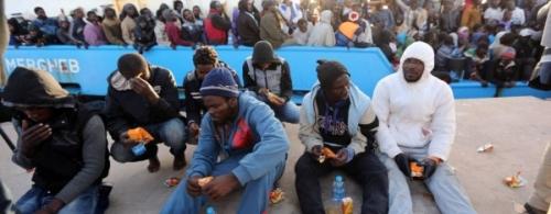 migrants-1-1-600x235.jpg
