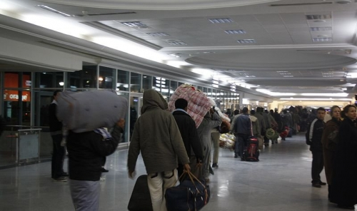 800px-Bangladeshi_migrants_from_Libya_at_Djerba_airport-dfid-800x475.jpg